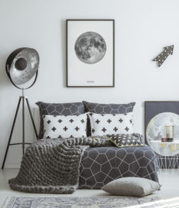 Patterned grey bedroom interior